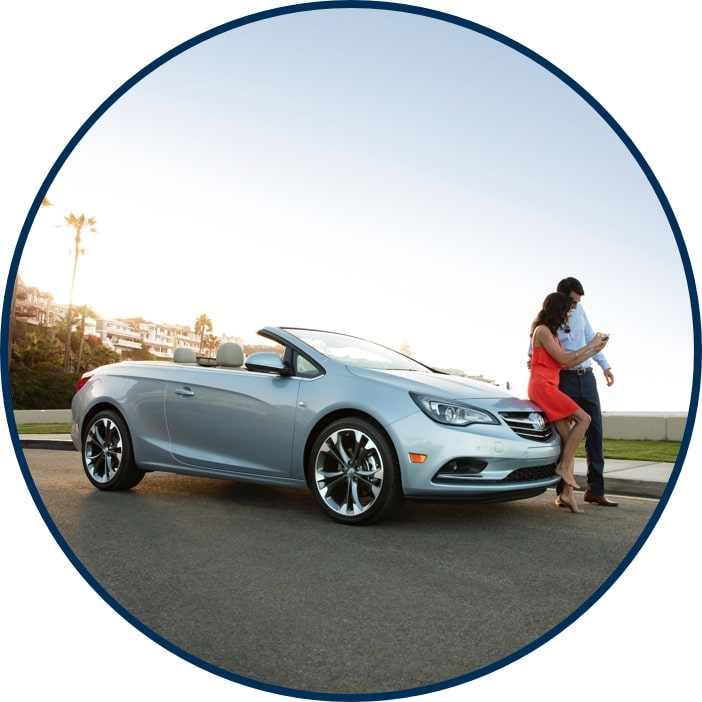 CPO Buick Cascada with couple sitting on hood